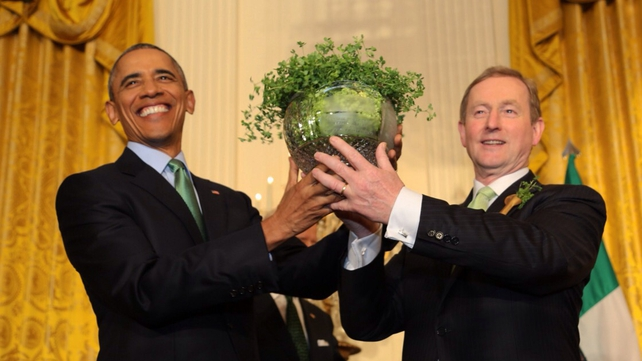 Barack Obama is presented with a bowl of Shamrock by Enda Kenny