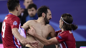 Atletico Madrid's defender Juanfran celebrates with teammates after kicking the winning penalty