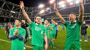 Wes Hoolahan, Robbie Brady and Jonathan Walters celebrate after Ireland's qualification for Euro 2016