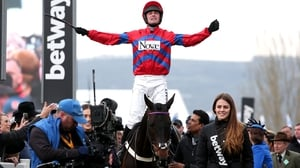 Nico de Boinville celebrates winning the The Queen Mother Champion Chase onboard Sprinter Sacre