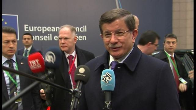 Turkey's Ahmet Davutoglu speaking before entering the meeting