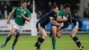 Ireland's Brett Connon is tackled by George Taylor and Tom Galbraith of Scotland