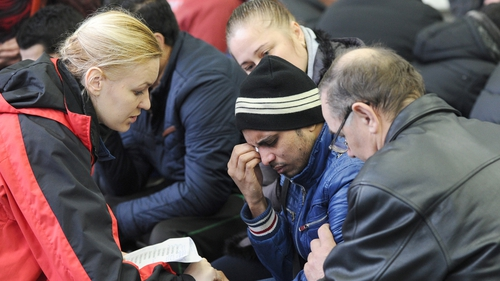 A relative of a passenger on board the flydubai craft is comforted by an emergency psychologist