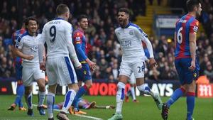 Riyad Mahrez heads towards Jamie Vardy after scoring for Leicester