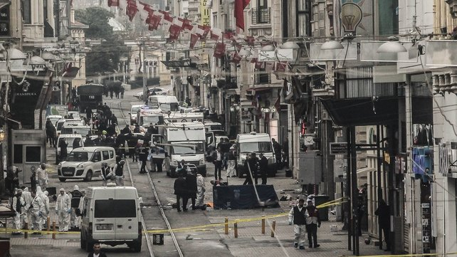 Emergency services inspecting the area following an attack in a major shopping district in Istanbul, Turkey