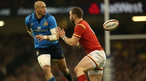 Italy's Sergio Parisse (L) in action against Wales