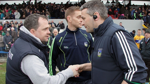 Clare manager Davy Fitzgerlad (L) and Limerick manager TJ Ryan shake hands after the game