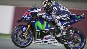 Jorge Lorenzo lifts the front wheel at Losail Circuit