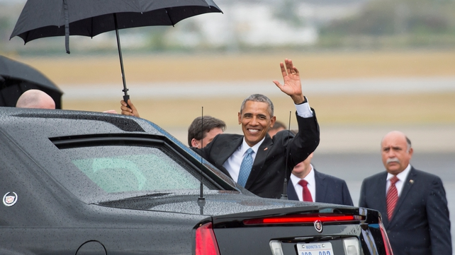 US President Barack Obama waves as he gets in his limousine upon arrival at the Jose Marti International Airport in Havana, Cuba