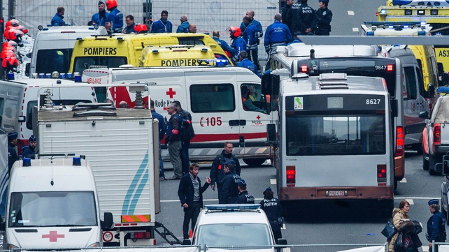 Belgian police and rescue workers on the Rue de la Loi