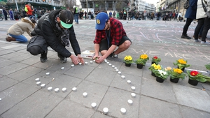 Candles and flowers are left outside the stock exchange building in Brussels in tribute to the victims of the bomb attacks