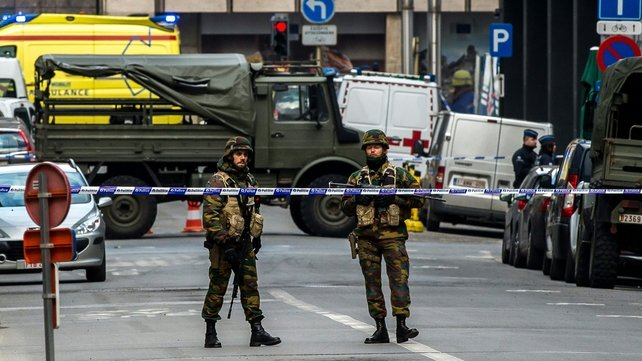 Soldiers block the access to roads close to the Maalbeek metro station in Brussels
