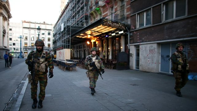 Security forces patrol in Brussels following the attacks