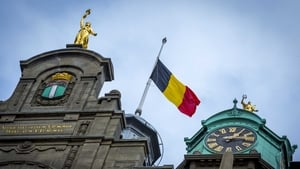The Belgian flag flys at half-mast at the city hall in Rotterdam