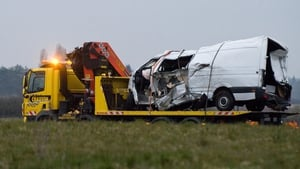 The wreckage of the minibus is taken from the scene