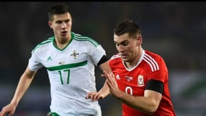 Northern Ireland's Paddy McNair tracks Sam Vokes of Wales during Thursday night's friendly