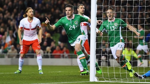 Ciaran Clark wheels away to celebrate his early goal against Switzerland
