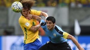 Luis Suarez (R) battles with David Luiz