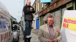 Paul Kelly and Michael 'Mattress Mick' Flynn on location