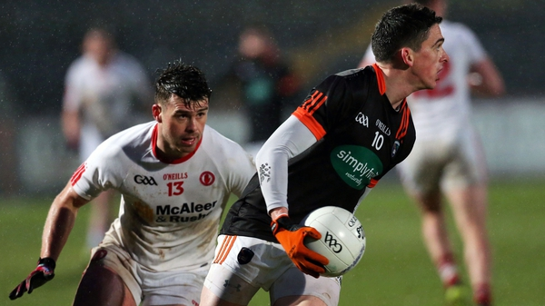 Tyrone's Darren McCurry puts Armagh's Rory Grugan under pressure