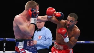 Kell Brook lands a right shot on Kevin Bizier