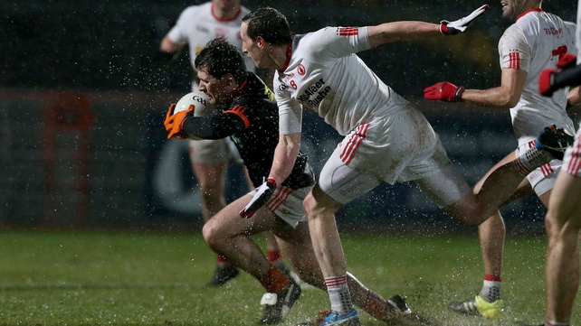 Tyrone's Colm Cavanagh chases down Miceal McKenna of Armagh