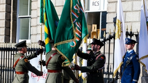 Two flags - the Irish Republic Flag and the Starry Plough - are handed over at a flag ceremony at the RCSI