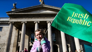Six-year-old Grace Nic Mhathúna awaiting the parade