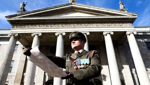 Captain Peter Kelleher reads the Proclamation of the Irish Republic in front of the GPO