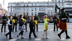 Children representing the four provinces laid bouquets of daffodils at the GPO