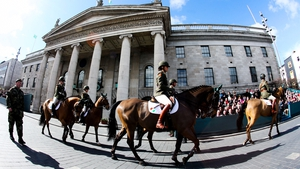 Mounted members of the Defence Forces parade past the GPO