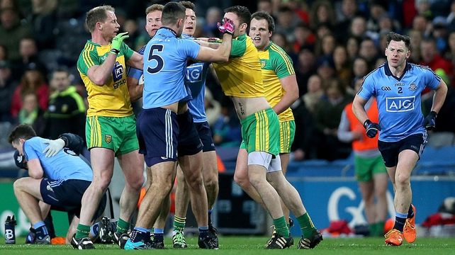 Dublin's James McCarthy clashes with Martin McElhinney of Donegal