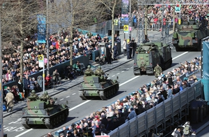 Armoured vehicles take part in the parade