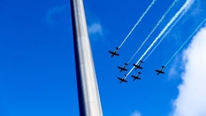 An Air Corps fly-past seen behind the Spire on O'Connell Street