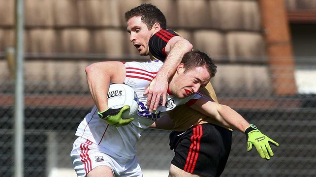 Cork's Colm O'Neill is tackled by Aidan Carr of Down