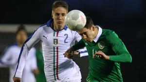 Republic of Ireland's Callum O'Dowda nods away from Andrea Conti of Italy