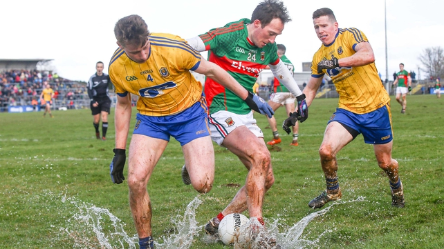 Roscommon and Mayo players splash around at Hyde Park during their Division 1 meeting last Sunday