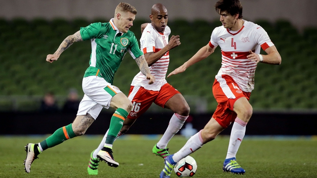 Ireland's James McClean with Gelson Fernandes and Timm Klose of Switzerland