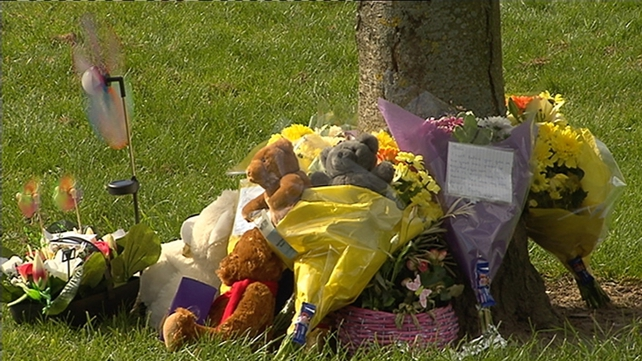 Flowers and toys left near where the bodies were discovered