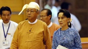 Myanmar's new president Htin Kyaw (L) and democracy leader Aung San Suu Kyi arrive at the parliament