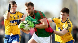 Aidan O'Shea (C) is accosted by Roscommon's Conor Daly and Sean Purcell