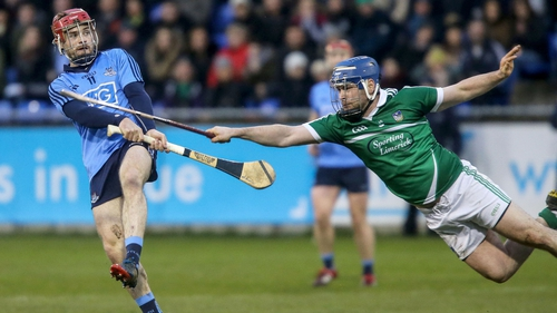 Dublin's Niall McMorrow gets the ball away under pressure from Richie McCarthy of Limerick