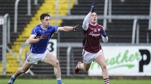 Galway's Eamon Brannigan battles for possession with Killian Brady of Cavan