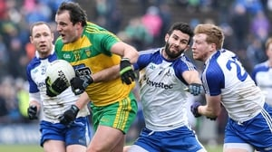 Michael Murphy of Donegal and Neil McAdam of Monaghan scrap for possession