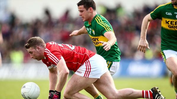 Kerry's Shane Enright tackles Brian Hurley of Cork