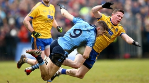 Dublin's Emmet O Conghaile and Sean McDermott of Roscommon get in a tangle