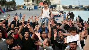 People shout 'No Turkey' at the port in Chios where refugees and migrants who broke out from Vial detention centre are camped out