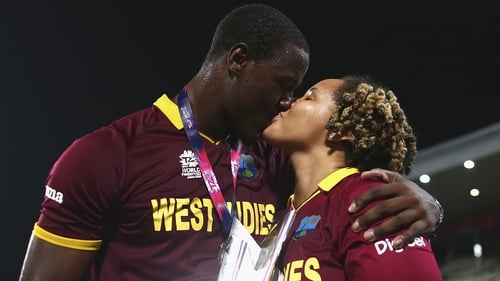 Carlos Brathwaite and his partner celebrate a famous victory