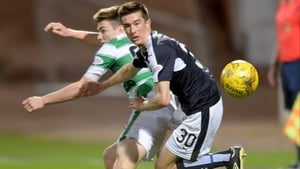 Dundee's Cameron Kerr beat's Celtic'S Kieran Tierney to the ball