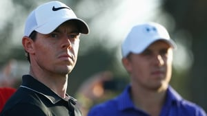 Rory McIlroy (L) was one of just four men to shoot a 71 at Augusta on Friday